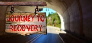 "A sign that says ""Journey to Recovery"""